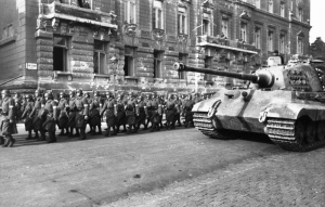 Hungarian militiamen parade alongside a German tank in Budapest, 1944. Source: Wikimedia